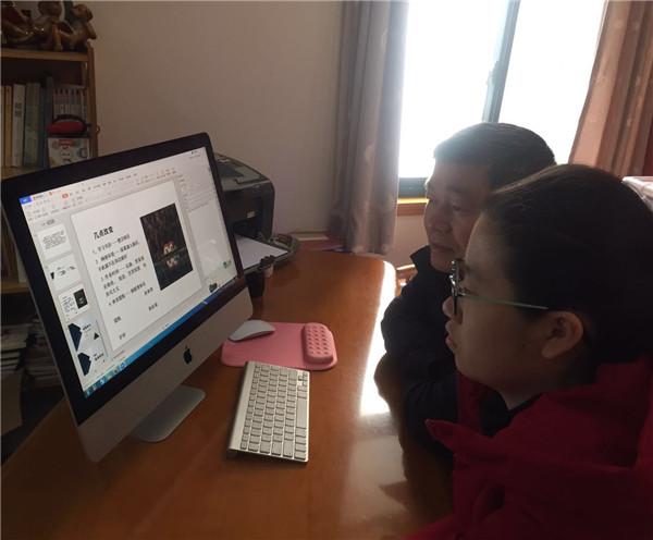 8班陳欣芝和家長共同參加會議.jpg